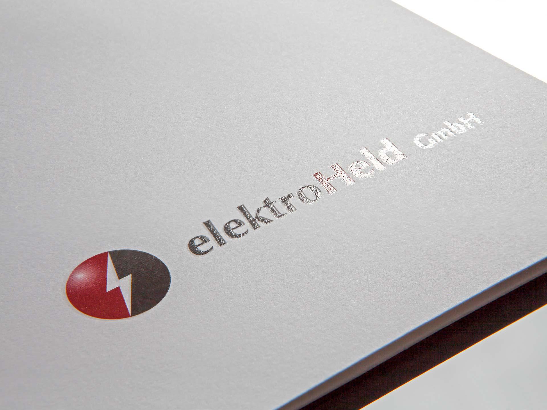 Elekro Held GmbH - Logo auf Image-Mappe, Zweifarbendruck und partieller UV-Lack