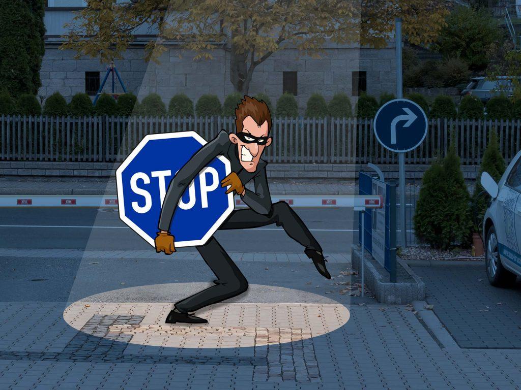Dieb beim Stehlen des blauen Stoppschildes